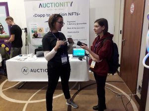 Svetlana pitching Auctionity with a journalist